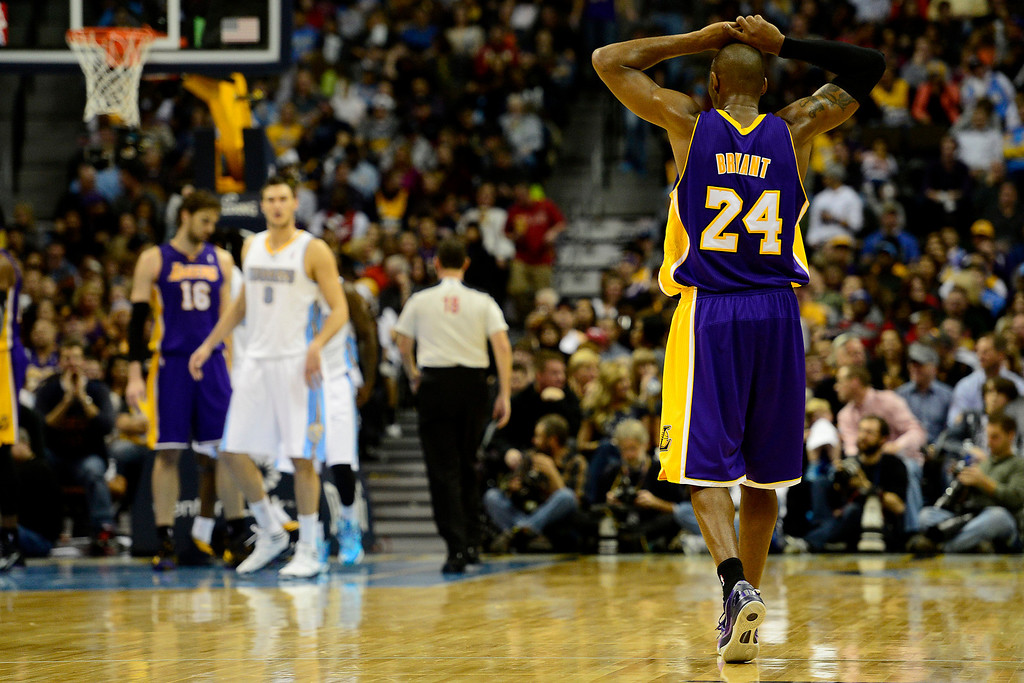 . Los Angeles Lakers shooting guard Kobe Bryant (24) reacts to a foul call on Los Angeles Lakers shooting guard Jodie Meeks (20) during the second half of the Nuggets\' 126-114 win at the Pepsi Center on Wednesday, December 26, 2012. AAron Ontiveroz, The Denver Post