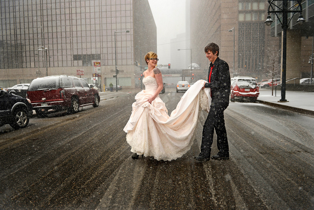 . Erin Ivie, 23, left, and her partner, Kristyn Lindstrom, 25, take part in wedding photos out in the snow after their civil-union ceremony in downtown Denver on May 1, 2013. Hundreds of Colorado gay and lesbian couples put an official government seal on their relationships.