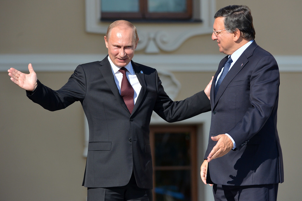 . In this handout image provided by Host Photo Agency, Russian President Vladimir Putin (L) greets President of the European Commission Jose Manuel Barroso during an official welcome of G20 heads of state and government, heads of invited states and international organizations at the G20 summit on September 5, 2013 in St. Petersburg, Russia.  (Photo by Alexey Kudenko/Host Photo Agency via Getty Images)
