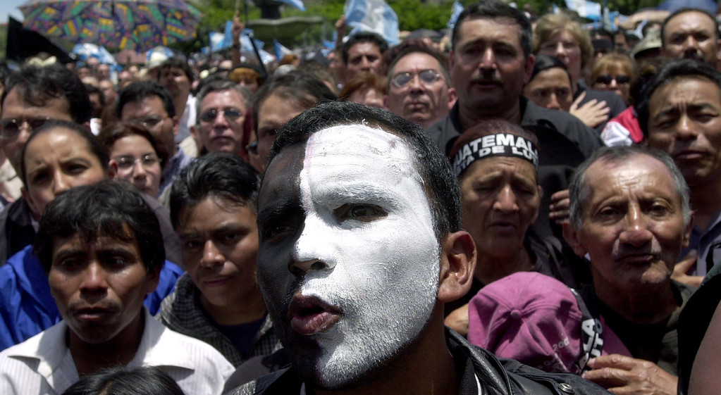 . Luis Marroquin wears mourning colors on his face to represent grief for the death of the guatemalan constitution during a desmotration against former dictator  Efrain Rios Montt\'s presidential candidacy in Guatemala City, Sunday, July 20, 2003.  After a decade of  being banned from running for president by the constitution, Rios won an appeal at the Constitutional Court. Despite serious allegations of human rights abuses in the past, Rios Montt retains a 7% of vote intention according to the polls. (APPhoto/ Rodrigo Abd)