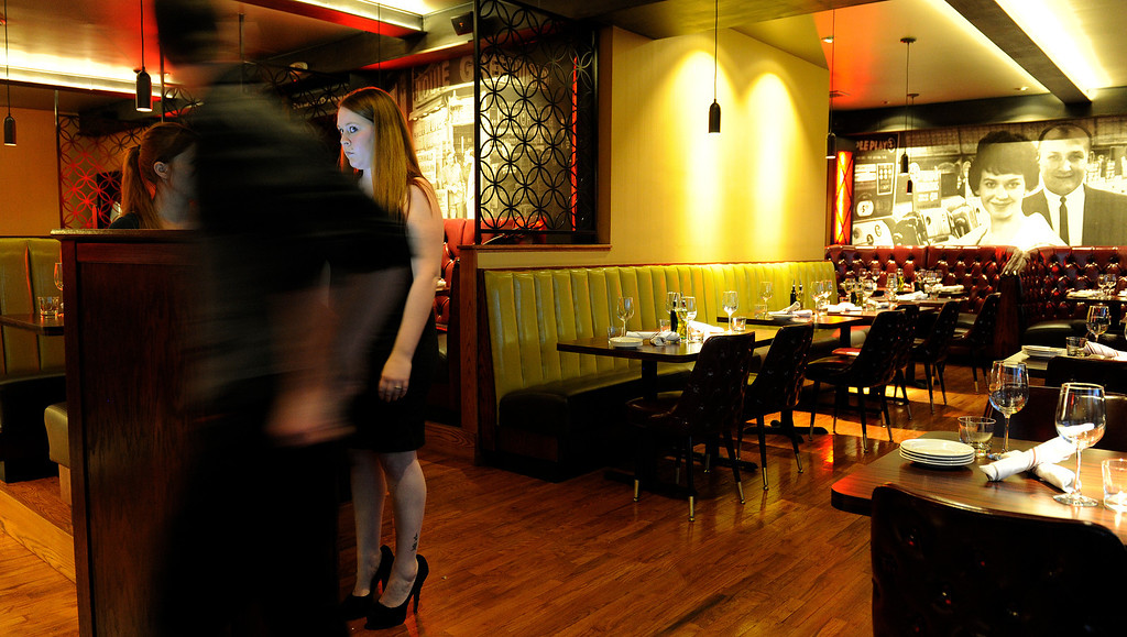 . Dining review of the newly remodeled Gaetano\'s in NW Denver at Tejon and W. 38th Ave on Tuesday, December 4, 2012. Anneka Kern at the hostess station.   Cyrus McCrimmon, The Denver Post