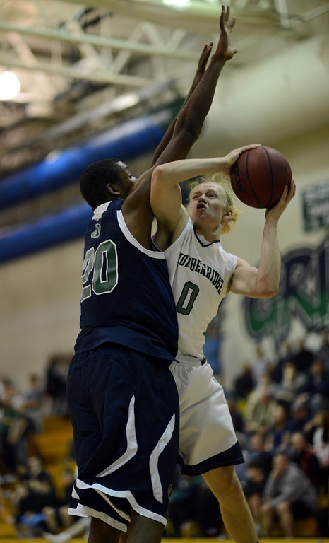 . HIGHLANDS RANCH, CO. - MARCH 02: Joe Marucci of ThunderRidge High School #0, controls the ball against De\'Ron Davis of Overland High School #20 during the 2nd round of 5A playoff game at ThunderRidge High School. March 2, 2013. Highlands Ranch, Colorado. ThunderRidge won 67-57. (Photo By Hyoung Chang/The Denver Post)