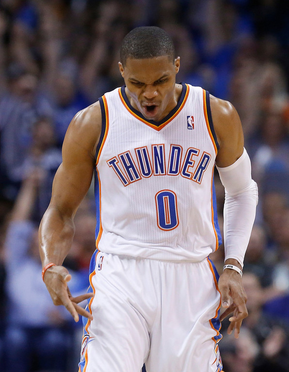 . Oklahoma City Thunder guard Russell Westbrook (0) reacts after hitting a shot in the second quarter of an NBA basketball game against the Denver Nuggets in Oklahoma City, Monday, Nov. 18, 2013. (AP Photo/Sue Ogrocki)