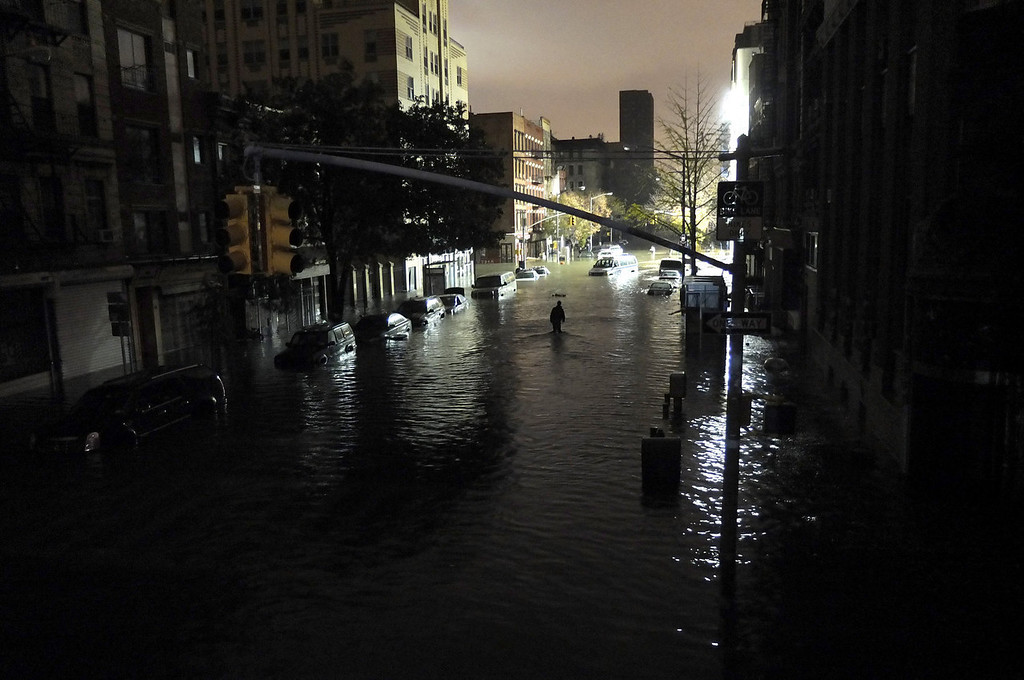. A general view of submerged cars on Ave. C and 7th st, after severe flooding caused by Hurricane Sandy, on October 30, 2012 in Manhattan, New York. The storm has claimed at least 16 lives in the United States, and has caused massive flooding across much of the Atlantic seaboard. US President Barack Obama has declared the situation a \'major disaster\' for large areas of the US East Coast including New York City, with wide spread power outages and significant flooding in parts of the city. (Photo by Christos Pathiakis/Getty Images)