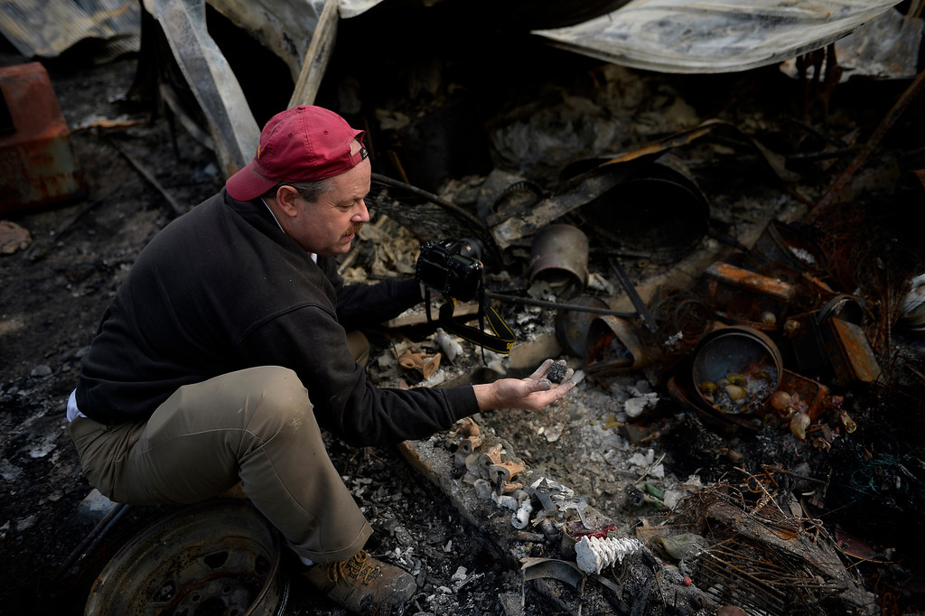. Ted Robertson holds a small baby Jesus he found in the rubble as he sifts through the damage to his home that was totally taken by the fire as some residents were allowed back to see their homes in the Black Forest Fire area near Colorado Springs, Colorado. June 18, 2013. The nativity ornament was very important to the families holidays as no one could open their Christmas presents until they had found the baby Jesus that his wife Teresa had hidden somewhere in the house. Denver, Colorado Springs. (Photo By Joe Amon/The Denver Post)