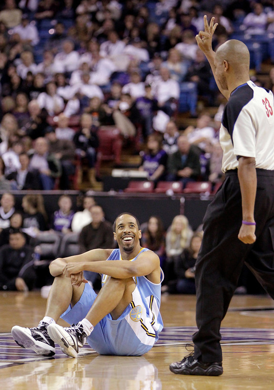 . Denver Nuggets guard Andre Miller as smiles  as he was called for a foul by official Sean Corbin during the third quarter of an NBA basketball game against the Sacramento Kings in Sacramento, Calif., Sunday, Dec. 16, 2012.  The Nuggets won 122-97.(AP Photo/Rich Pedroncelli)