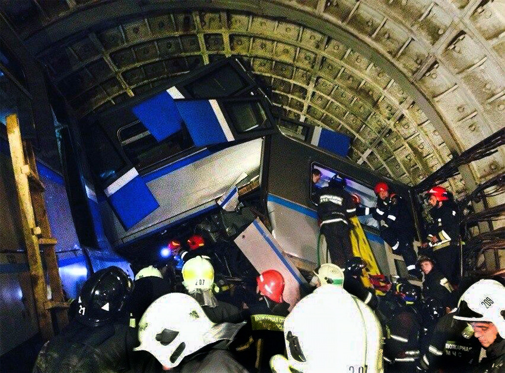. A picture taken by a cell phone shows rescuers working near a derailed subway train in a tunnel between Park Pobedy and Slavyansky Bulvar stations in Moscow, on July 15, 2014. At least twenty people died and scores more were hurt today after a train derailed in Moscow\'s packed metro during rush hour in the worst accident to hit one of the world\'s busiest subways.  AFP PHOTO / ITAR-TASS /  VARYA  VALOVIL/AFP/Getty Images