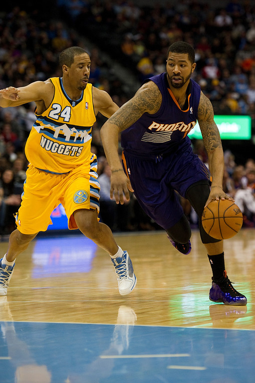 . DENVER, CO - DECEMBER 20: Andre Miller #24 of the Denver Nuggets tries to defend against Markieff Morris #11 of the Phoenix Suns at the Pepsi Center on December 20, 2013, in Denver, Colorado. The Suns won 103-99. (Photo by Daniel Petty/The Denver Post)
