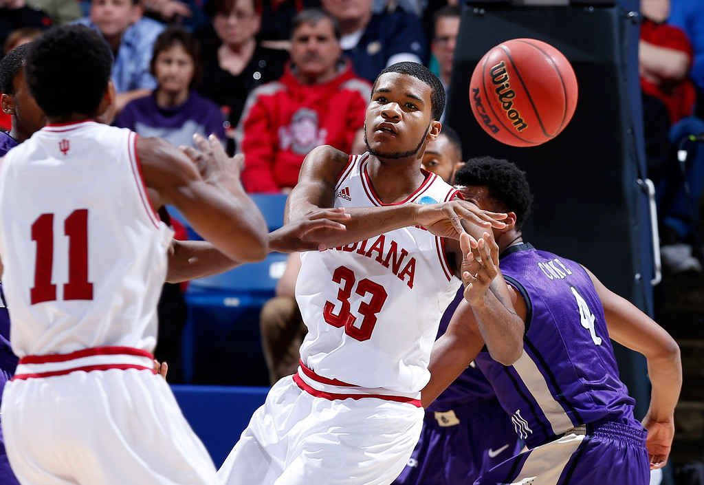 . DAYTON, OH - MARCH 22: Yogi Ferrell #11 of the Indiana Hoosiers passes to Jeremy Hollowell #33 against the James Madison Dukes in the first half during the second round of the 2013 NCAA Men\'s Basketball Tournament at UD Arena on March 22, 2013 in Dayton, Ohio.  (Photo by Joe Robbins/Getty Images)