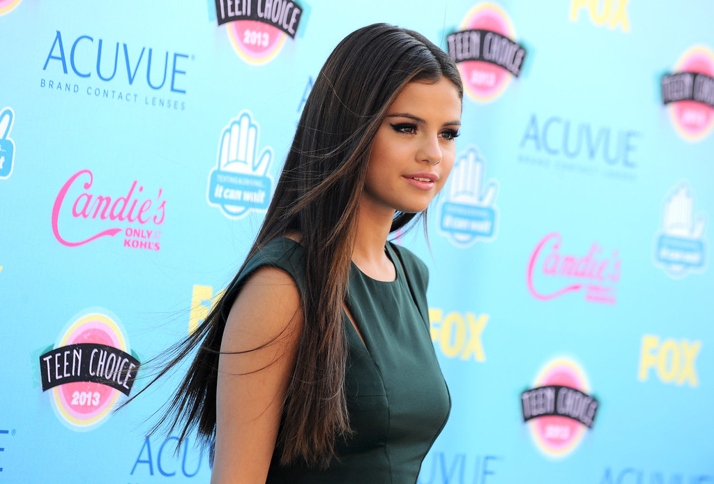 . Selena Gomez arrives at the Teen Choice Awards at the Gibson Amphitheater on Sunday, Aug. 11, 2013, in Los Angeles. (Photo by Jordan Strauss/Invision/AP)