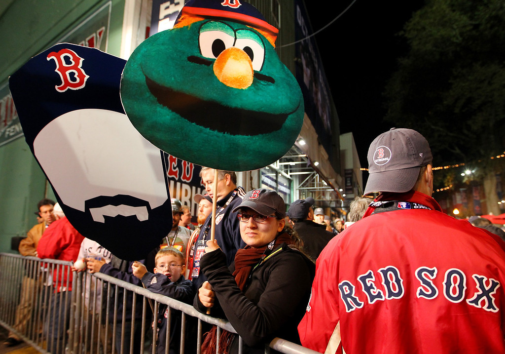 . Fans gather outside Fenway Park before Game Two of the 2013 World Series between the Boston Red Sox and the St. Louis Cardinals on October 24, 2013 in Boston, Massachusetts.  (Photo by Jamie Squire/Getty Images)