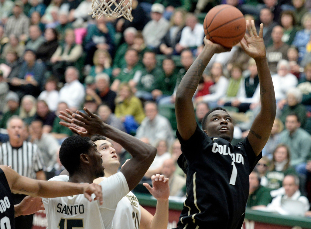 . CU\'s  Wesley Gordon takes a shot over Gerson Santo during an NCAA game against CSU on Tuesday, Dec. 3, 2013, at the Moby Arena in Fort Collins.