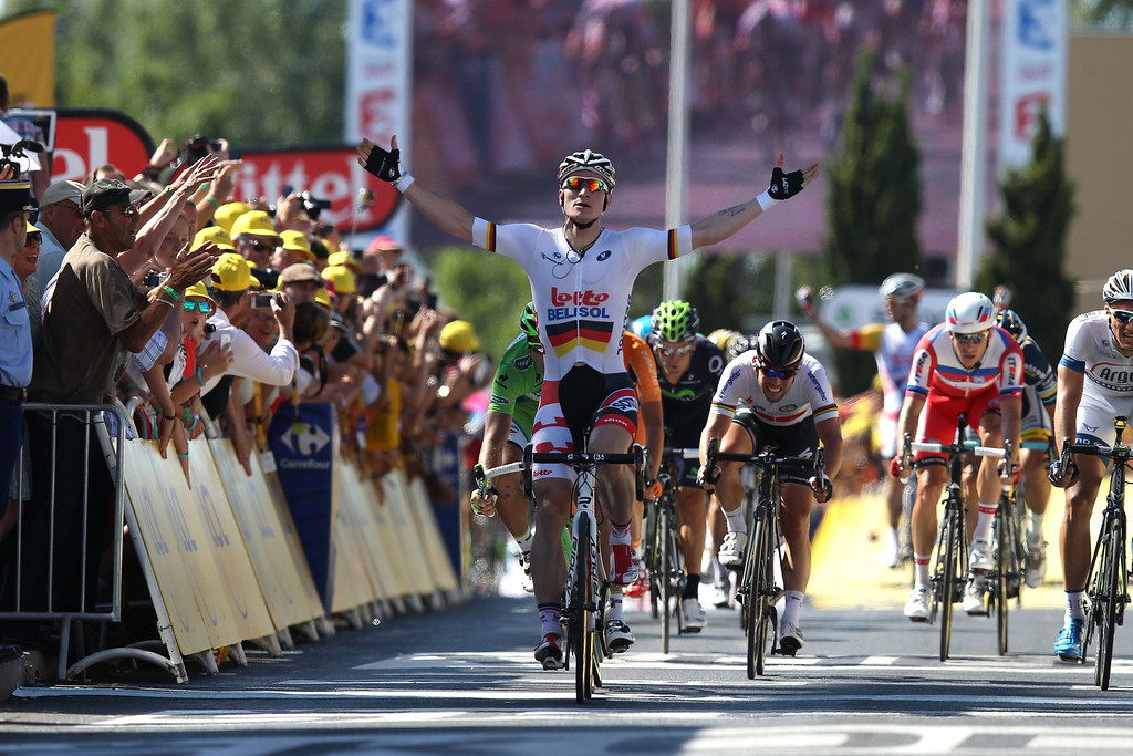 . MONTPELLIER, FRANCE - JULY 04:  Andre Greipel of Germany and Lotto-Belisol crosses the line to win stage six of the 2013 Tour de France, a 176.5KM road stage from Aix-en-Provence to Montpellier, on July 4, 2013 in Aix-en-Provence, France.  (Photo by Doug Pensinger/Getty Images)