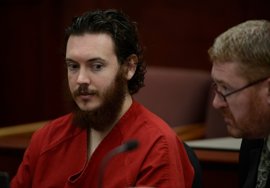 . James Holmes, left, and his defense attorney, Daniel King, in court  Tuesday morning June 04, 2013 for an advisement hearing at the Arapahoe County Justice Center. Holmes is accused of killing 12 people and injuring 70 others in a shooting rampage at an Aurora theater, July 20th, 2012. The court accepted James Holmes plea of not guilty by reason of insanity and has ordered a sanity evaluation at the Colorado Mental Health Institute of Pueblo. (Photo By Andy Cross/The Denver Post)