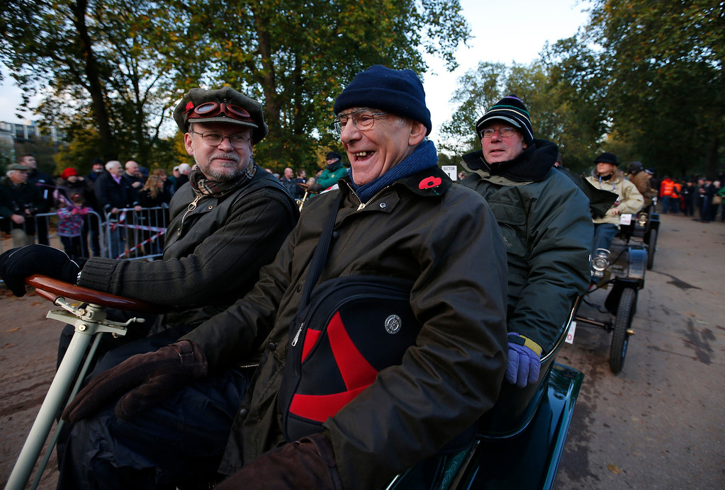 . Participants get ready at the start line in London\'s Hyde Park, during the London to Brighton Veteran Car Run, Sunday, Nov. 3, 2013. Over 400 pre-1905 vehicles made their way on the historic 60-mile run from Hyde Park in London to coastal Brighton in southern England, in the world\'s longest running motoring celebration spanning 117 years. (AP Photo/Lefteris Pitarakis)