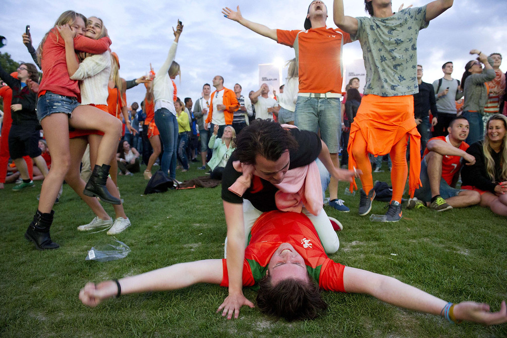 . Dutch football fans cheer at Museumplein in Amsterdam, The Netherlands, on June 13, 2014, after the Netherlands defeated Spain 5-1 during their 2014 FIFA World Cup match. EVERT ELZINGA/AFP/Getty Images