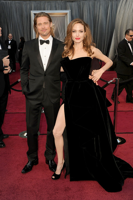 . Actor Brad Pitt (L) and actress Angelina Jolie arrive at the 84th Annual Academy Awards held at the Hollywood & Highland Center on February 26, 2012 in Hollywood, California.  (Photo by Jason Merritt/Getty Images)