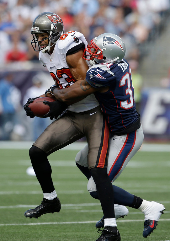 . New England Patriots cornerback Aqib Talib (31) tackles Tampa Bay Buccaneers wide receiver Vincent Jackson (83) in the first half of an NFL football game Sunday, Sept. 22, 2013, in Foxborough, Mass. (AP Photo/Stephan Savoia)