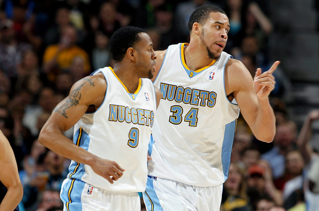 . Denver Nuggets forward JaVale McGee, right, celebrates after his basket with guard Andre Iguodala against the Oklahoma City Thunder in the first quarter of an NBA basketball game in Denver on Friday, March 1, 2013. (AP Photo/David Zalubowski)