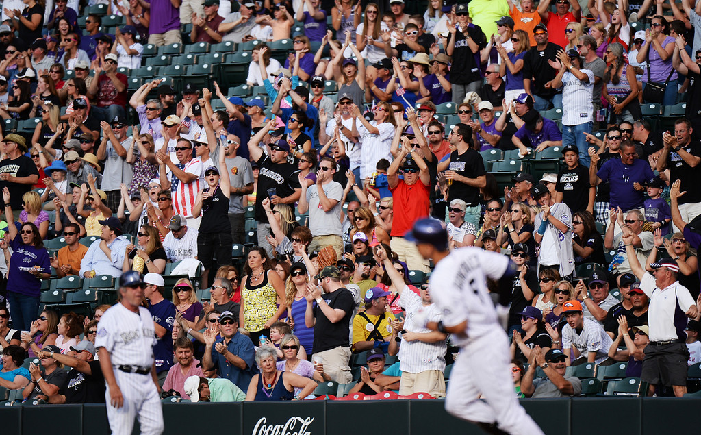 . DENVER, CO. - July 03: Colorado Rockies fans celebrate home run of Carlos Gonzalez of Colorado Rockies (5) in the 1st inning of the game against Los Angeles Dodgers at Coors Field. Denver, Colorado. July 3, 2013. (Photo By Hyoung Chang/The Denver Post)