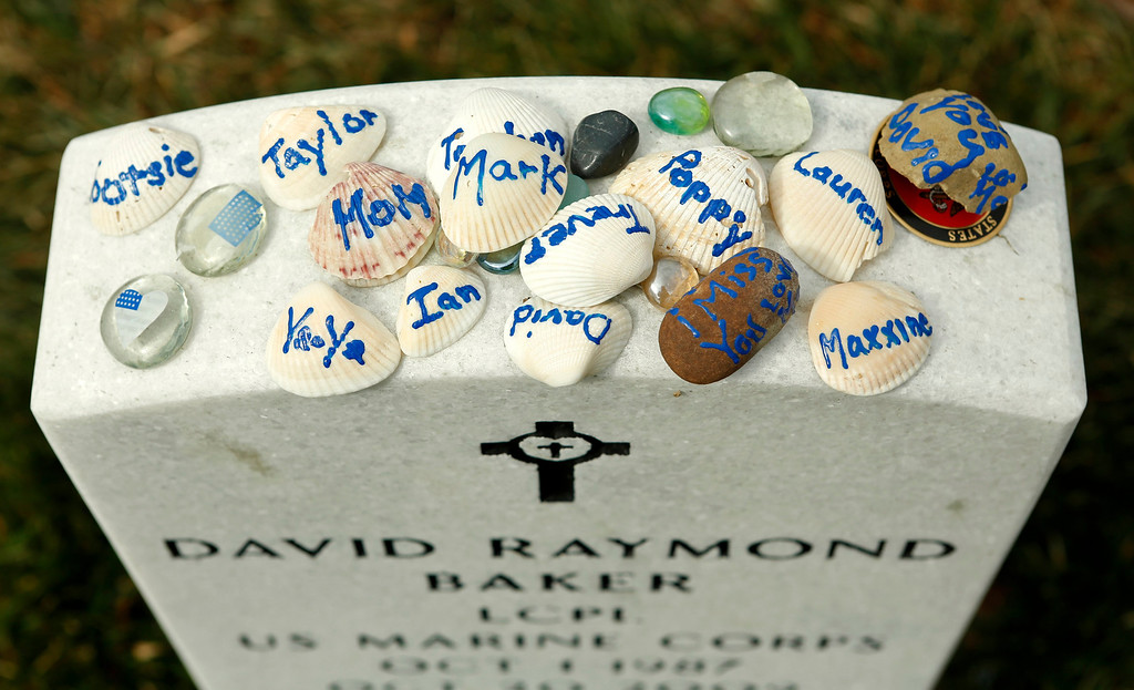 . Sea shells with names of loved ones  are seen on a headstone in Section 60 at Arlington National Cemetery in Virginia, March 13, 2013. Section 60 contains graves of soldiers from the wars in Iraq and Afghanistan. Picture taken March 13, 2013. REUTERS/Kevin Lamarque