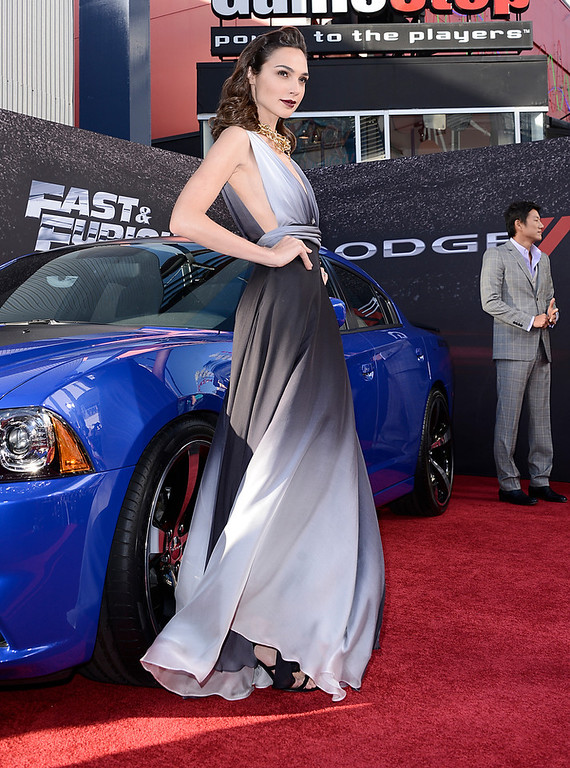 """. Actress Gal Gadot arrives at the LA Premiere of the \""""Fast & Furious 6\"""" at the Gibson Amphitheatre on Tuesday, May 21, 2013 in Universal City, Calif. (Photo by Dan Steinberg/Invision/AP)"""