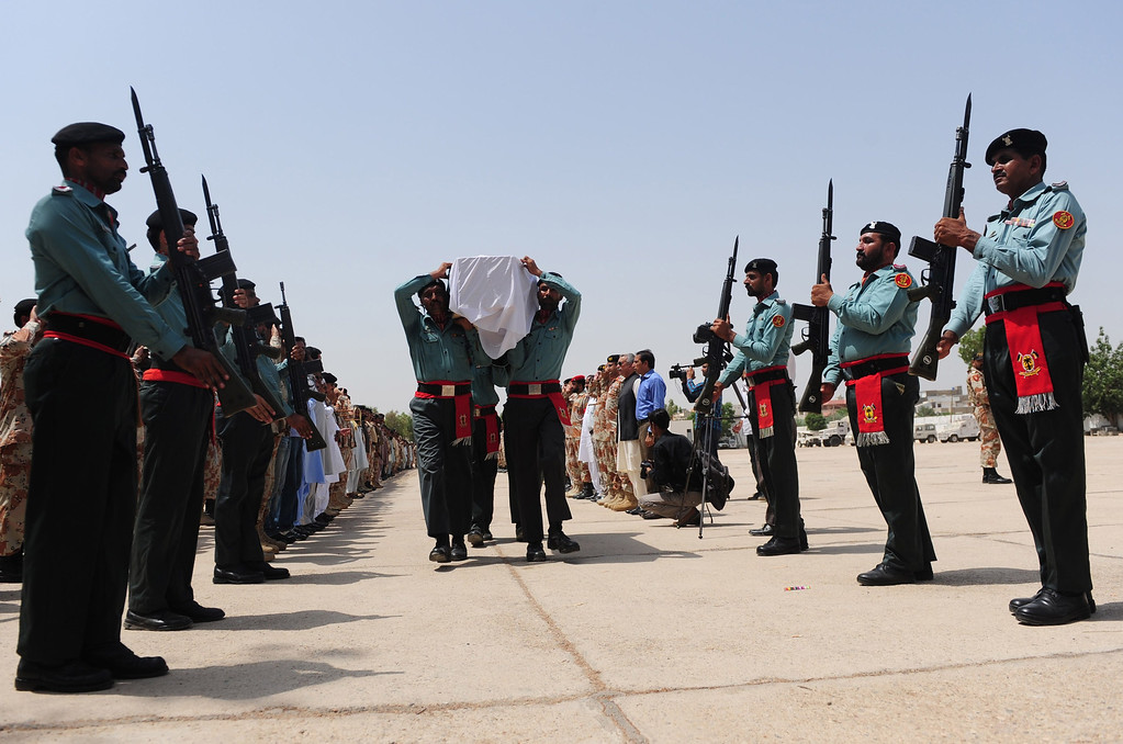 . Pakistani Rangers carry the coffin of a colleague killed during an assault by militants on Karachi airport during funeral ceremonies in Karachi on June 9, 2014.  AFP PHOTO/Rizwan TABASSUM/AFP/Getty Images