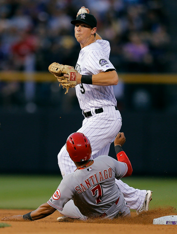. Colorado Rockies second baseman DJ LeMahieu forces out Cincinnati Reds\' Ramon Santiago (7) at second during the fourth inning of a baseball game Friday, Aug. 15, 2014, in Denver. Johnny Cueto was safe at first. (AP Photo/Jack Dempsey)