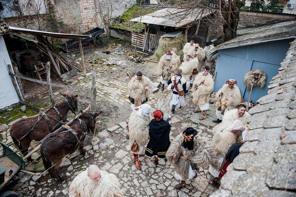 . Young revelers wear sheep-fur costumes as they get ready for the traditional carnival parade in the yard of a house in Mohacs, 189 kms south of Budapest, Hungary, 27 February 2014.  EPA/TAMAS SOKI