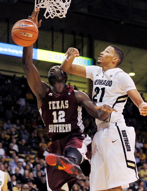. Colorado guard Andre Roberson, right, gives an elbow to Texas Southern forward Kyrie Sutton as they fight for control of a rebound in the first half of an NCAA college basketball game in Boulder, Colo., on Tuesday, Nov. 27, 2012. (AP Photo/David Zalubowski)