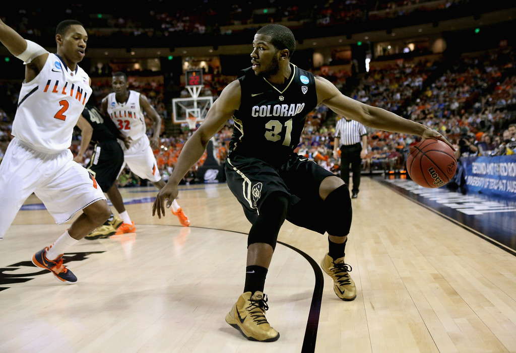. AUSTIN, TX - MARCH 22:  Jeremy Adams #31 of the Colorado Buffaloes controls the ball away from Joseph Bertrand #2 of the Illinois Fighting Illini during the second round of the 2013 NCAA Men\'s Basketball Tournament at The Frank Erwin Center on March 22, 2013 in Austin, Texas.  (Photo by Stephen Dunn/Getty Images)
