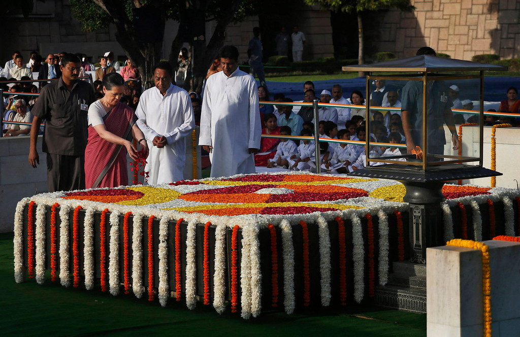 . India\'s ruling Congress Party President Sonia Gandhi offers floral tributes at a memorial of Mahatma Gandhi on the occasion of his birth anniversary, in New Delhi, India, Wednesday, Oct. 2, 2013. (AP Photo/Saurabh Das)
