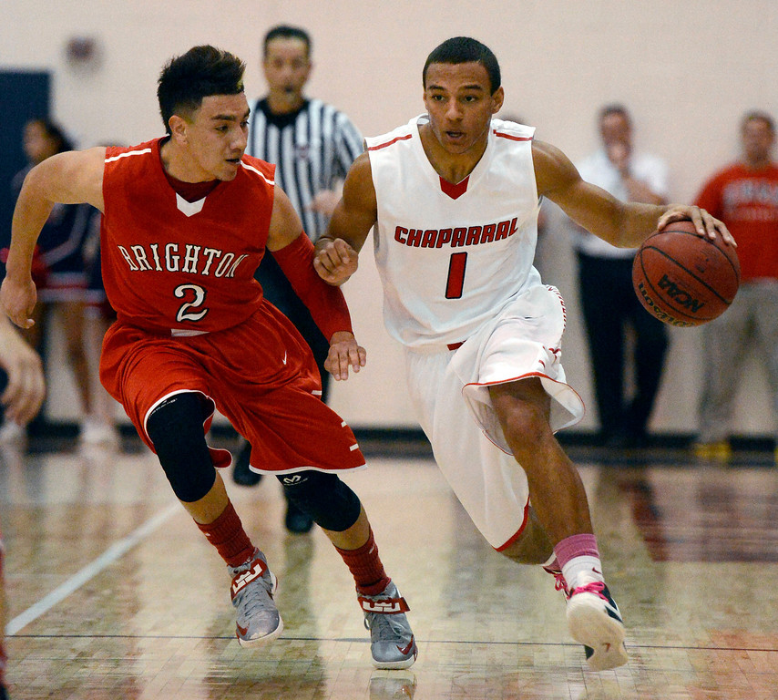 . Brighton\'s Nathan Morales (2) tries to catch up to Chaparral\'s Brandon Malone (1) as he brings the ball up court during the second quarter February 27, 2013. (Photo By John Leyba/The Denver Post)