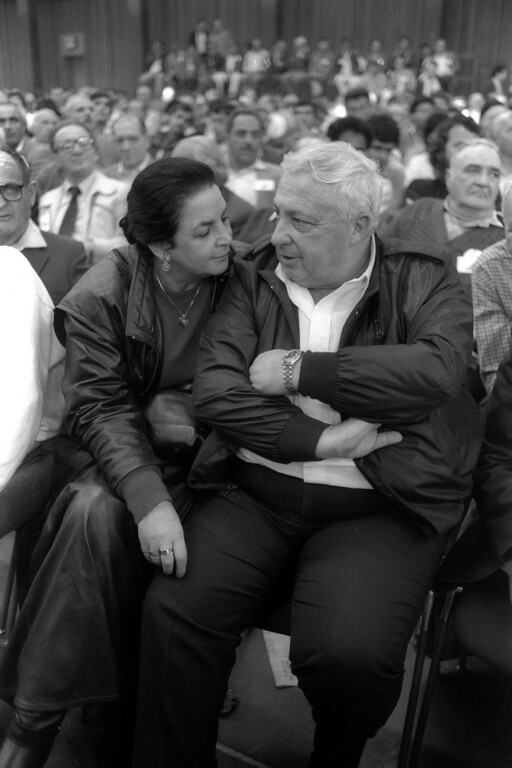. In this handout from the Israeli Governmental Press Office, Ariel Sharon and his wife Lily sit in the audience during a convention of the right-wing Herut party March, 10, 1986 in Tel Aviv. (Photo by Nati Harnik/GPO via Getty Images)