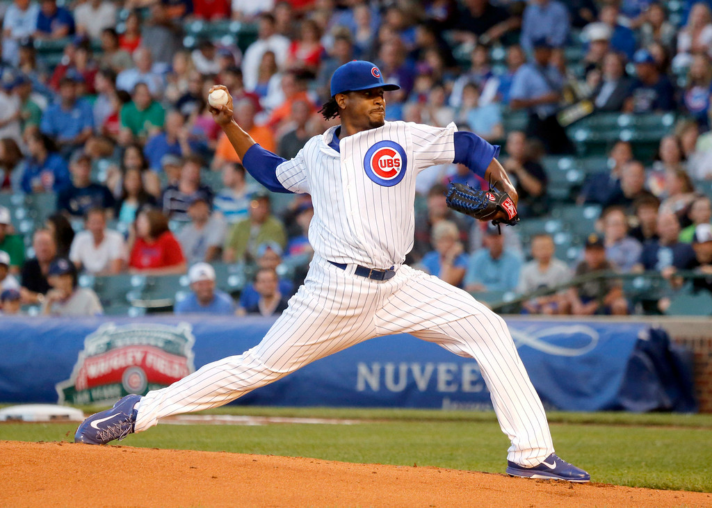 . Chicago Cubs starting pitcher Edwin Jackson delivers during the first inning of a baseball game against the Colorado Rockies, Tuesday, July 29, 2014, in Chicago. (AP Photo/Charles Rex Arbogast)