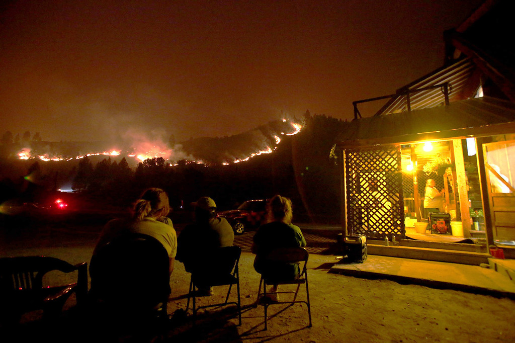 . People watch the 80,300-acre Elk Complex Fire burning on hill next to Pine, Idaho, on Sunday, Aug. 11, 2013.  (AP Photo/Times-News,Ashley Smith)