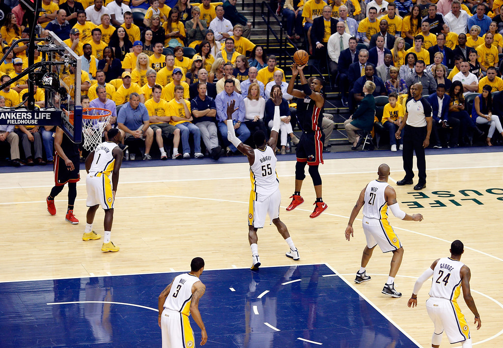 . INDIANAPOLIS, IN - MAY 28:  Chris Bosh #1 of the Miami Heat takes a shot against the Indiana Pacers during Game Five of the Eastern Conference Finals of the 2014 NBA Playoffs at Bankers Life Fieldhouse on May 28, 2014 in Indianapolis, Indiana.  (Photo by Joe Robbins/Getty Images)