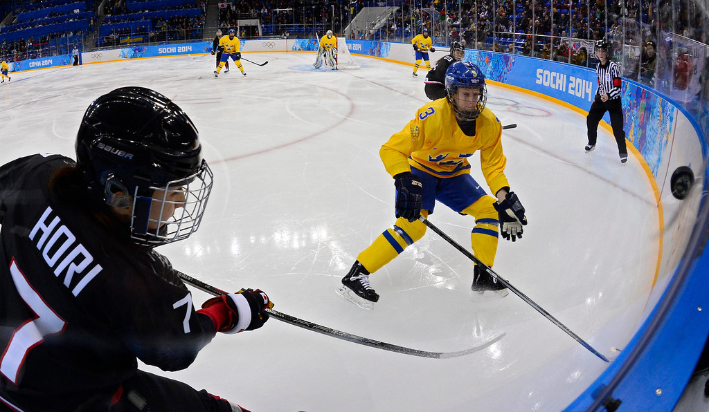 . Sofia Engstrom (R) of Sweden goes for the puck against Mika Hori (L) of Japan in the second period during the match between Sweden and Japan at the Shayba Arena in the Ice Hockey tournament at the Sochi 2014 Olympic Games, Sochi, Russia, 09 February 2014  EPA/LARRY W. SMITH
