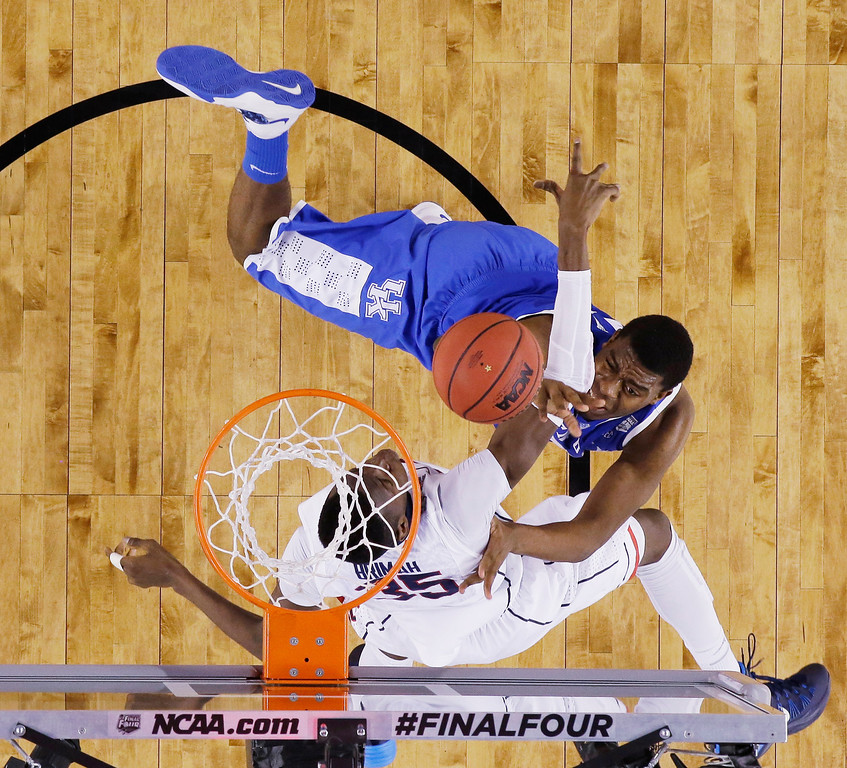 . Kentucky center Dakari Johnson, top, shoots over Connecticut center Amida Brimah during the second half of the NCAA Final Four tournament college basketball championship game Monday, April 7, 2014, in Arlington, Texas. (AP Photo/David J. Phillip)