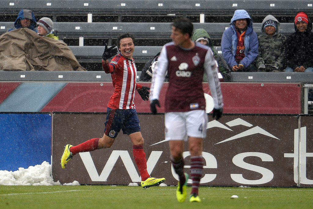 . Erick Torres (9) of Chivas USA celebrates his 1-0 goal as Marc Burch (4) of Colorado Rapids walks up field during the second half. Chivas USA defeated the Colorado Rapids 3-1 on Sunday, May 11, 2014. (Photo by AAron Ontiveroz/The Denver Post)