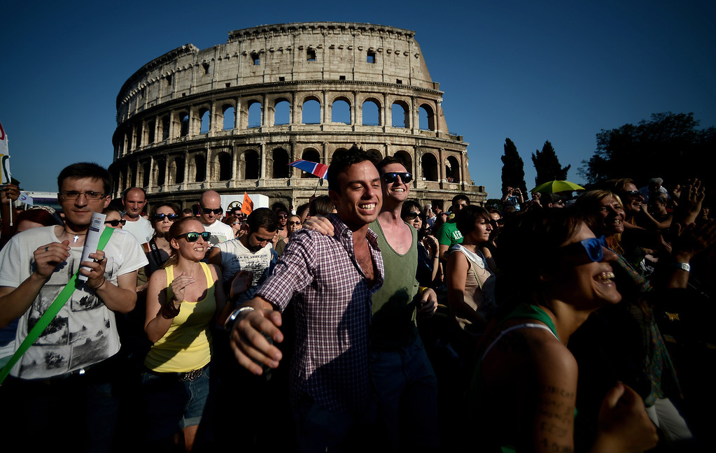 . People take part in the annual gay pride parade in downtown Rome on June 15, 2013. Tens of thousands of people paraded noisily on floats through the historic streets of Rome on June 15 to celebrate Gay Pride, amid calls for Italy to follow France\'s example in legalising gay marriage.  AFP PHOTO/ FILIPPO  MONTEFORTE/AFP/Getty Images