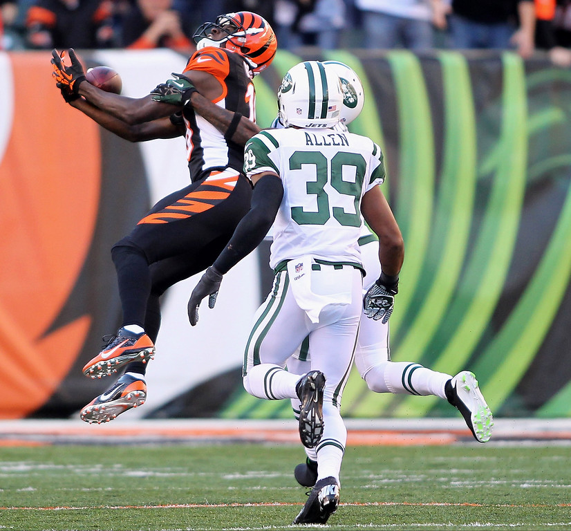 . A.J. Green #18 of the Cincinnati Bengals hauls in the pass during the game against the New York Jets at Paul Brown Stadium on October 27, 2013 in Cincinnati, Ohio.  (Photo by John Grieshop/Getty Images)