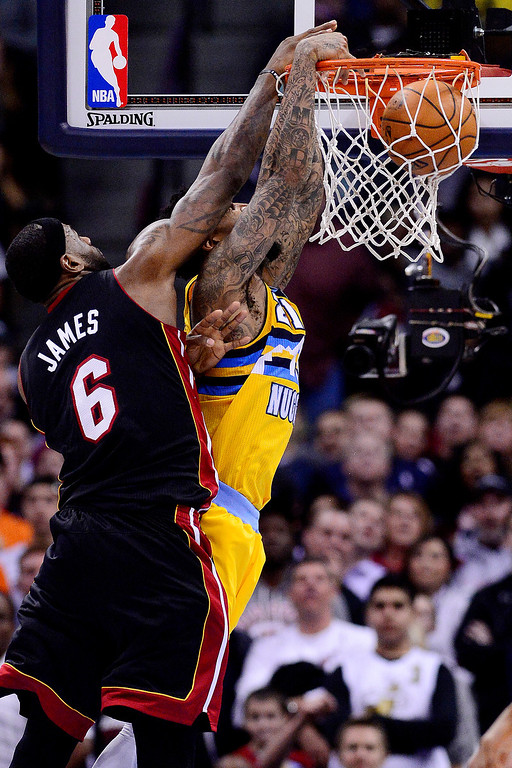. Wilson Chandler (21) of the Denver Nuggets dunks against LeBron James (6) of the Miami Heat during the second half of Miami\'s 97-94 win.  (Photo by AAron Ontiveroz/The Denver Post)