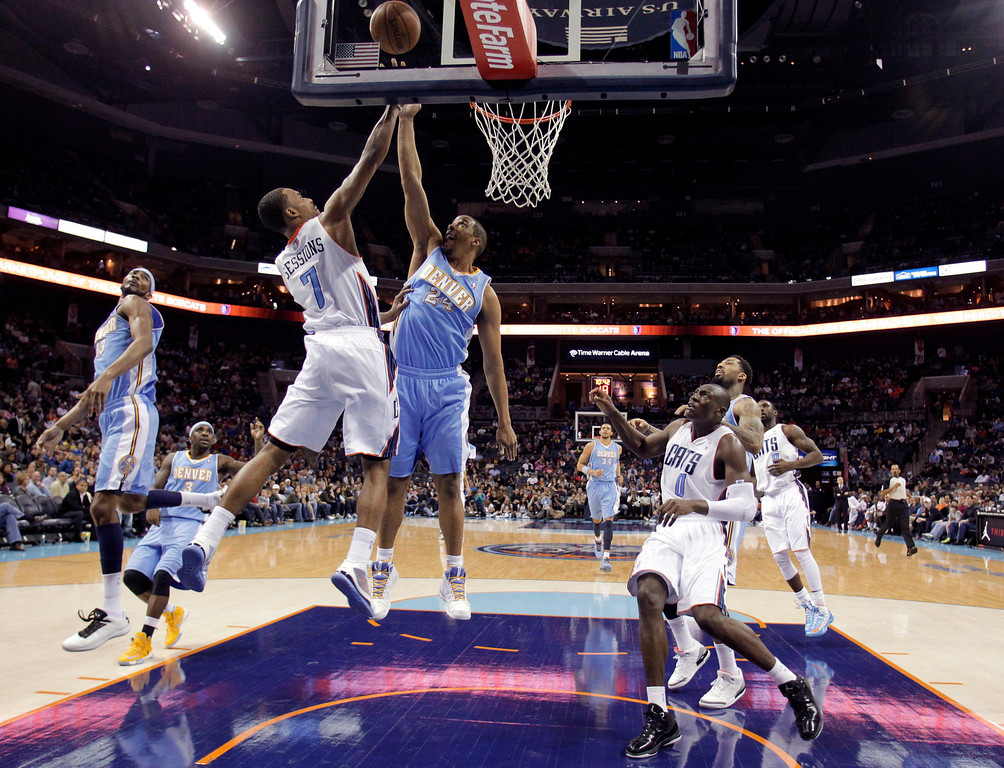 . Charlotte Bobcats\' Ramon Sessions (7) has his shot blocked by Denver Nuggets\' Andre Miller (24) during the second half of an NBA basketball game in Charlotte, N.C., Saturday, Feb. 23, 2013. The Nuggets won 113-99. (AP Photo/Bob Leverone)