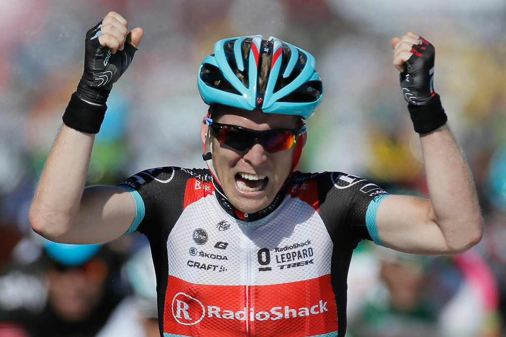 . Jan Bakelants of Belgium crosses the finish line to win the second stage of the Tour de France cycling race over 156 kilometers (97.5 miles) with start in Bastia and finish in Ajaccio, Corsica island, France, Sunday June 30, 2013. (AP Photo/Laurent Rebours)