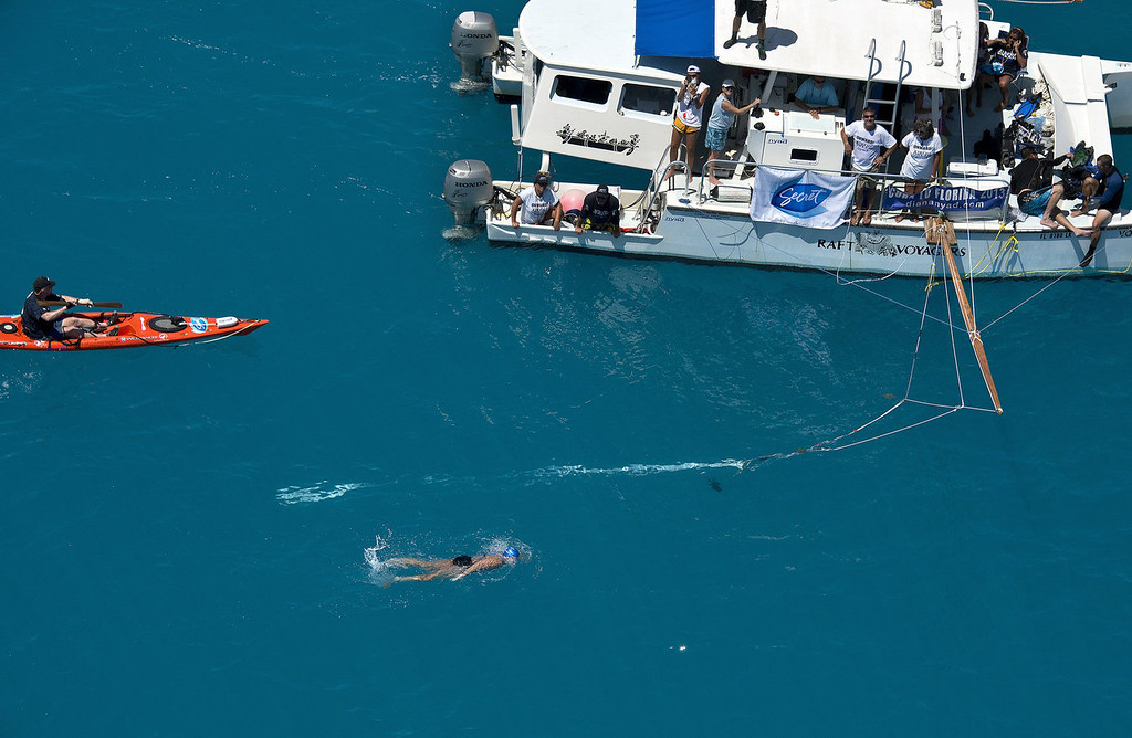 . Diana Nyad, positioned about two miles off Key West, Fla., Monday, Sept. 2, 2013, swims towards the completion of her approximately 110-mile trek from Cuba to the Florida Keys. Nyad, 64, is poised to be the first swimmer to cross the Florida Straits without the security of a shark cage.   (AP Photo/Florida Keys News Bureau, Andy Newman)