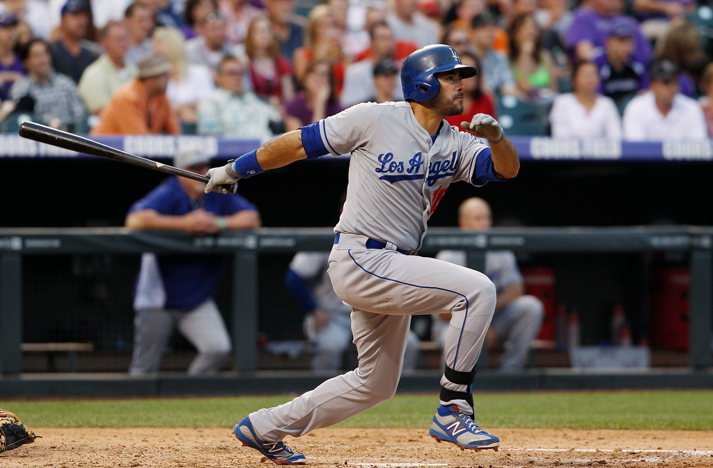 . Los Angeles Dodgers\' Andre Ethier singles against the Colorado Rockies in the fifth inning of a baseball game in Denver, Thursday, July 4, 2013. (AP Photo/David Zalubowski)
