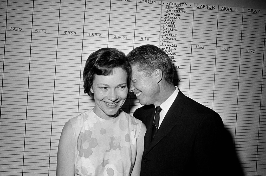 . FILE - In this Sept. 15, 1966 file photo, then Georgia State Sen. Jimmy Carter hugs his wife, Rosalynn, at his Atlanta campaign headquarters. Jimmy Carter and his wife Rosalynn celebrate their 65th anniversary this week on Thursday, July 7, 2011. (AP Photo/File)