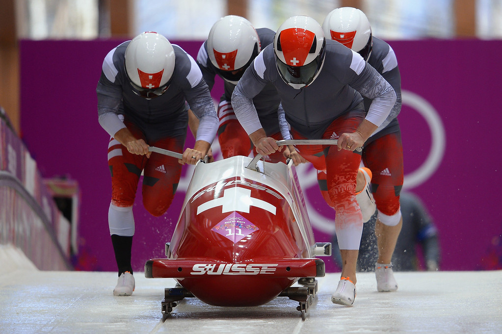 . Pilot Beat Hefti, Alex Baumann, Juerg Egger and Thomas Lamparter of Switzerland team 1 make a run during the Men\'s Four-Man Bobsleigh on Day 16 of the Sochi 2014 Winter Olympics at Sliding Center Sanki on February 23, 2014 in Sochi, Russia.  (Photo by Lars Baron/Getty Images)