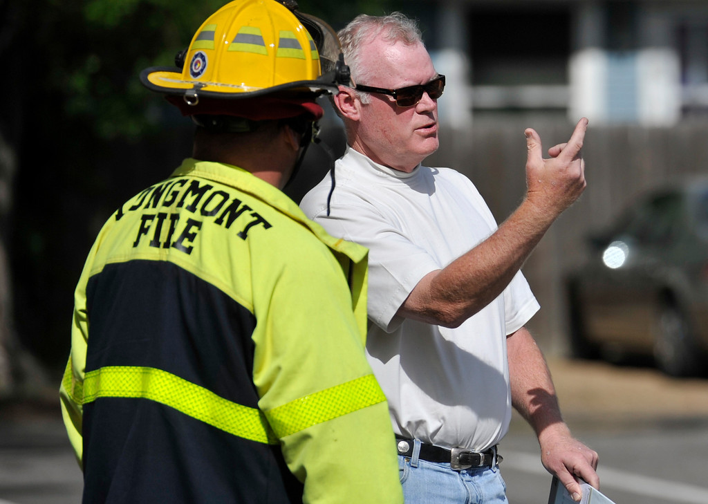 . Funeral home owner Geoff Howe, right, talks with a Longmont Firefighter, Tuesday, May 28, 2013, at Howe Mortuary and Cremation Services in Longmont. (Matthew Jonas/Times-Call)